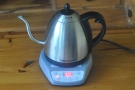 Press this & a green light comes on. When the kettle reaches the set temperature, it holds it.