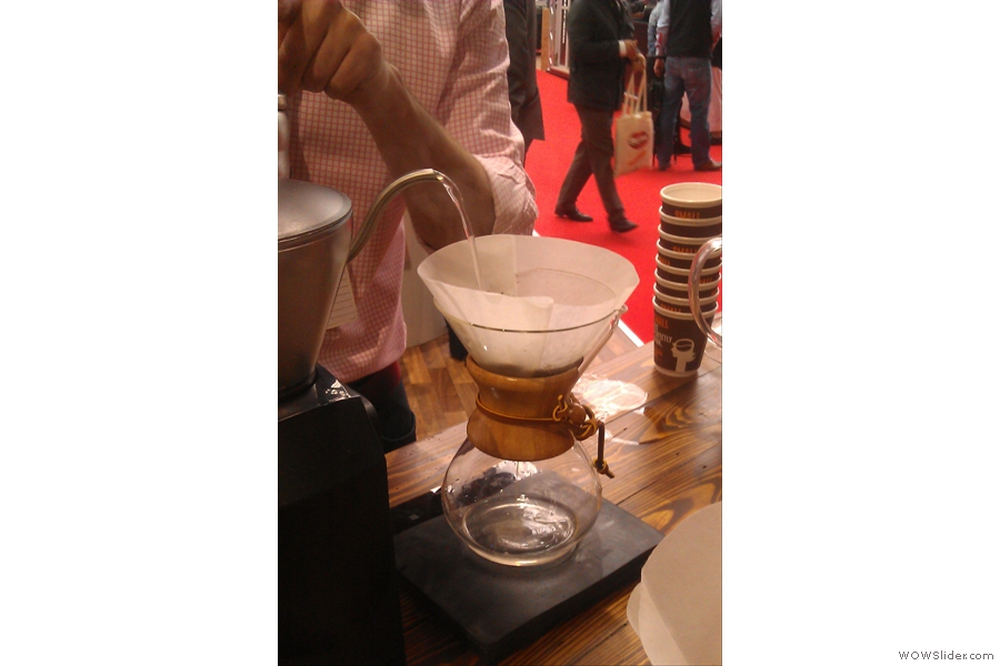 Unlike the pour-over, the water is weighed as it is poured to ensure the precise dose is used. However,  as before, a small amount of water is poured in first to allow the grounds to bloom.