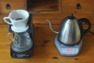 In goes the ground coffee. Once again, the kettle wanders +/- 1⁰C.