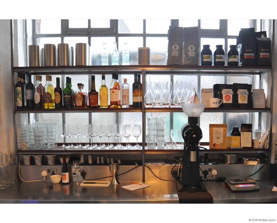 There's a fully-stocked bar at the back behind the counter, with the coffee on the right.