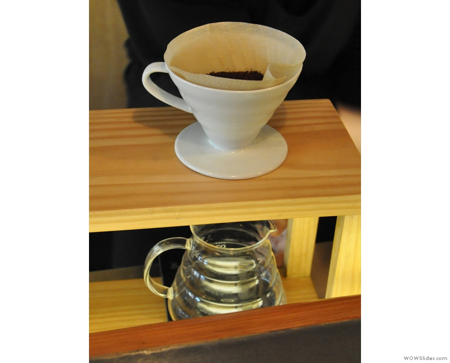 Step two, grind the coffee and put it in the V60.