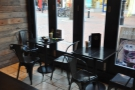 ... and these square tables in the windows to the right of the door.