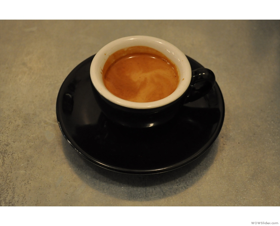 And here it is, my espresso in a classic black cup.