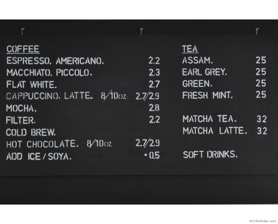 The concise menu is on the wall behind the counter.
