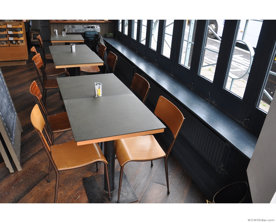 ... where these tables line the windows, which can be opened when it's not raining...