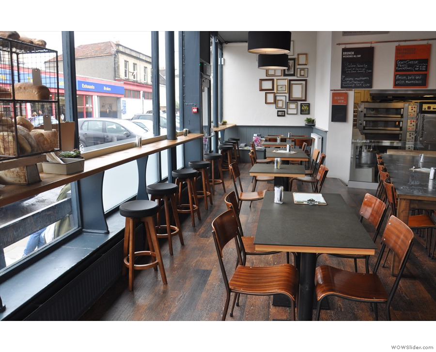 A row of four-person tables runs up alongside the windows...