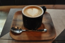 The result: my flat white, beautifully presesnted on a little tray...
