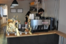 The counter, like Frequency, is long and thin, with the espresso machine at the front...