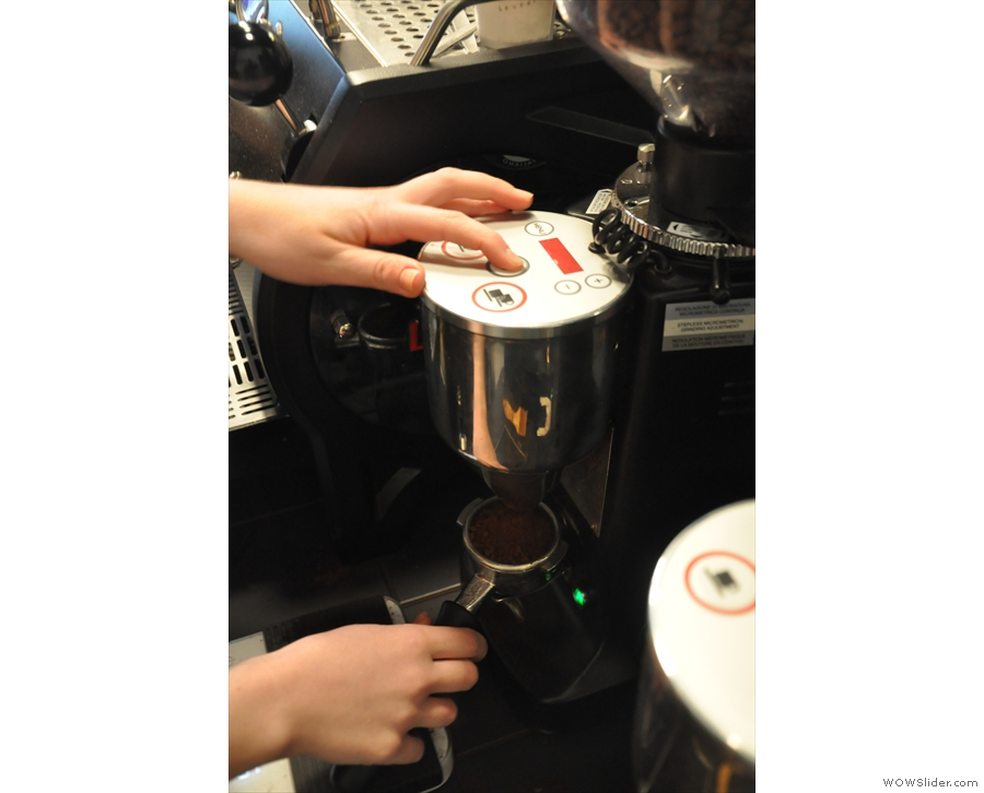 First, grind the coffee. The guest espresso has its own dedicated grinder.