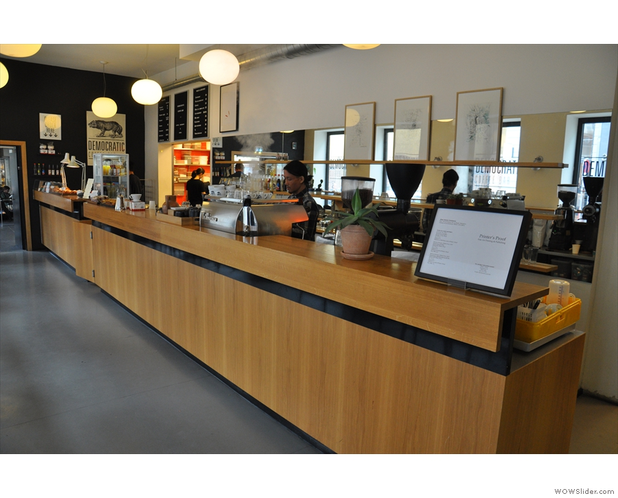 The counter is very long, with the coffee-making operation at the end nearest the door...