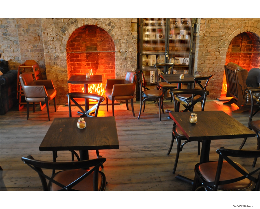 ... while there's more seating at the back by these fireplaces on the left.