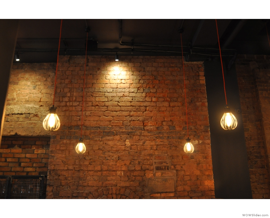More awesome lights, this time of the caged, bare-bulb variety, right at the back.
