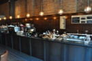 ... while the counter is to the right, food first, then the coffee.