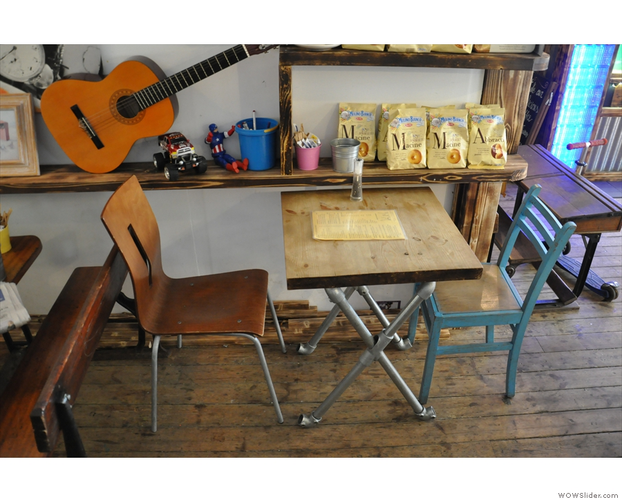 This table is tucked away on the opposite wall. I wonder if you're allowed to play the guitar?