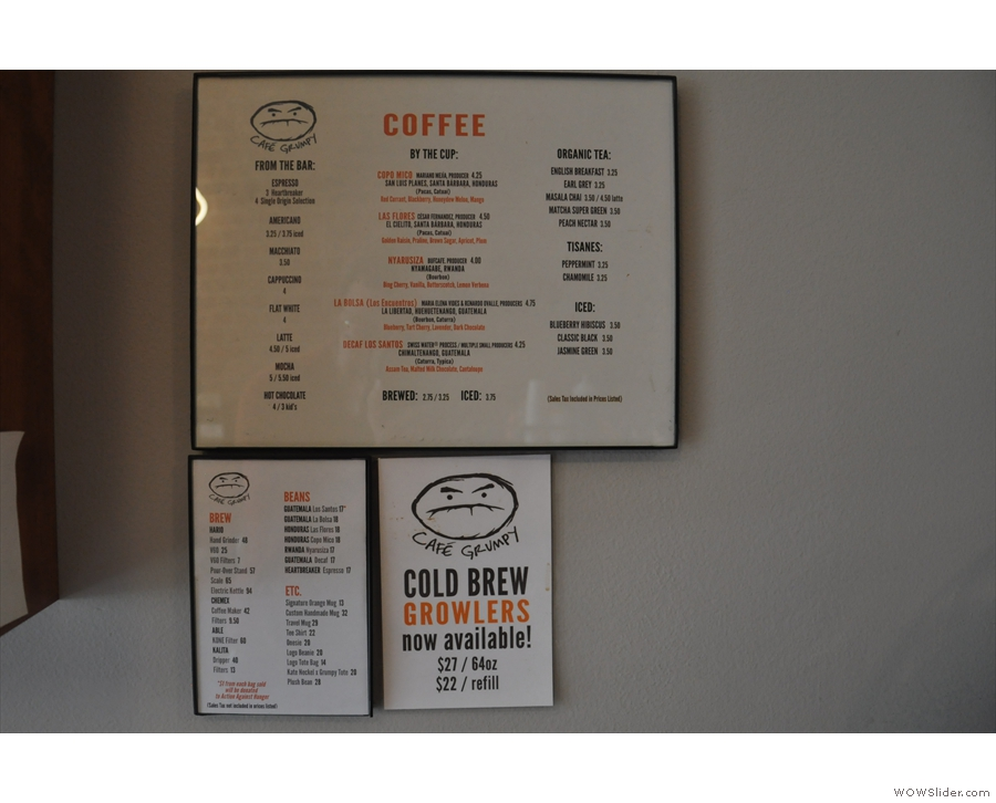 The coffee menus are on the wall next to the retail selection.