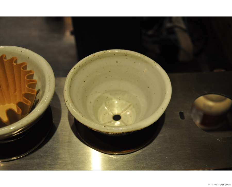 Sumerian uses these cone filters, which take Kalita Wave papers, but only have one hole.