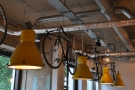 The Espresso Library has lots of light-fittings. These hang with the bicycles.