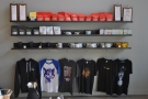... as well as t-shirts and branded cups on the shelves on the right-hand wall.