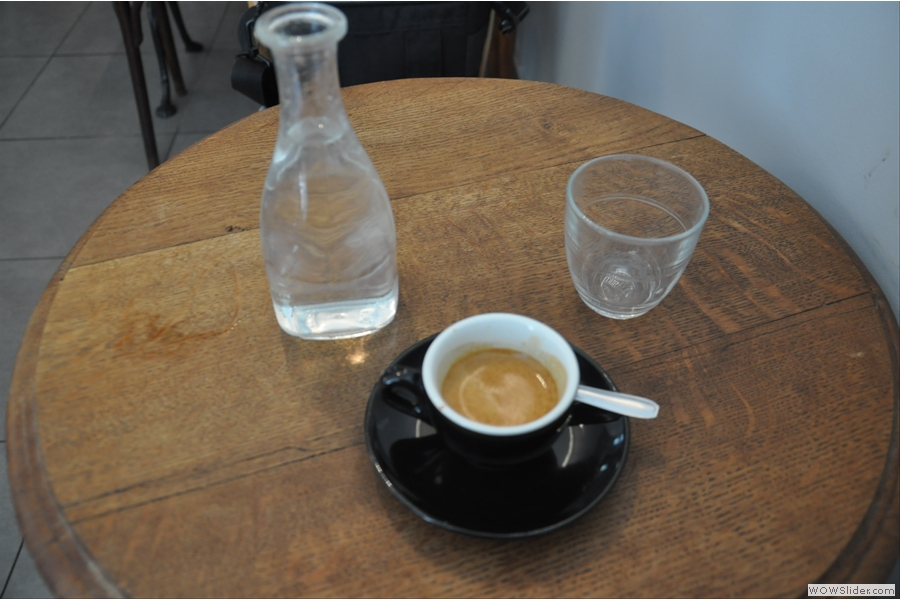 I order an espresso from local roasters Coutume which comes with a carafe of water. Nice touch.