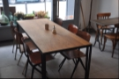 The large table in the middle.