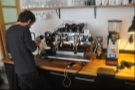 Baptiste steams the milk for a cafe au lait (think flat white)