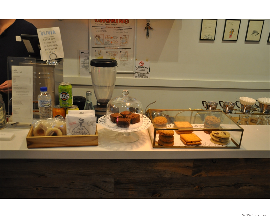 The middle part of the counter is kept free for cakes and the till.