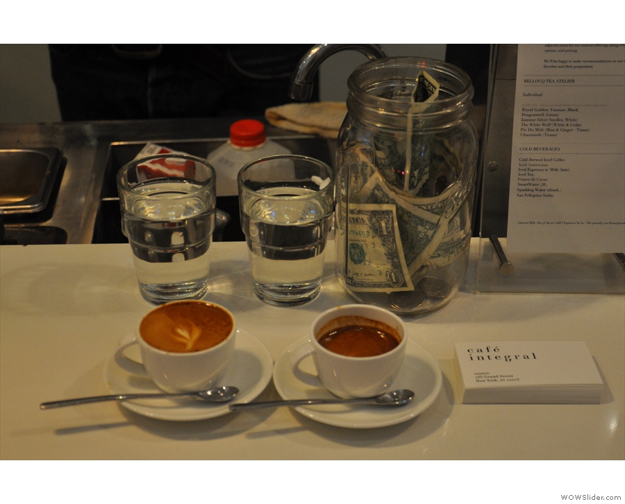 Another order, a macchiato and an espresso, plus two glasses of water, ready to go.