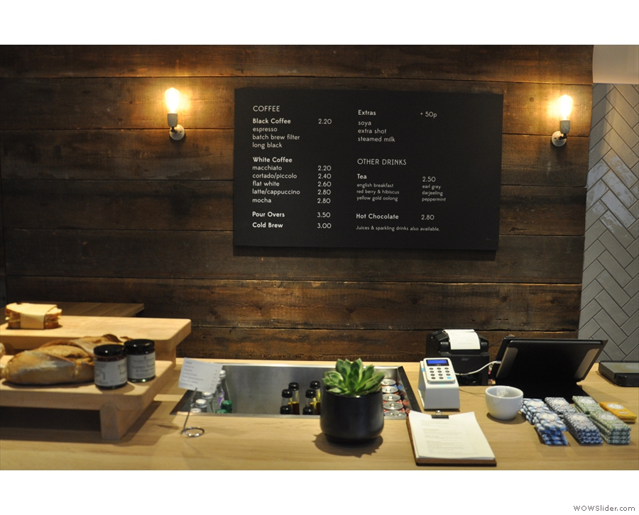 The till is in the middle, with the menu conveniently located on the wall behind.
