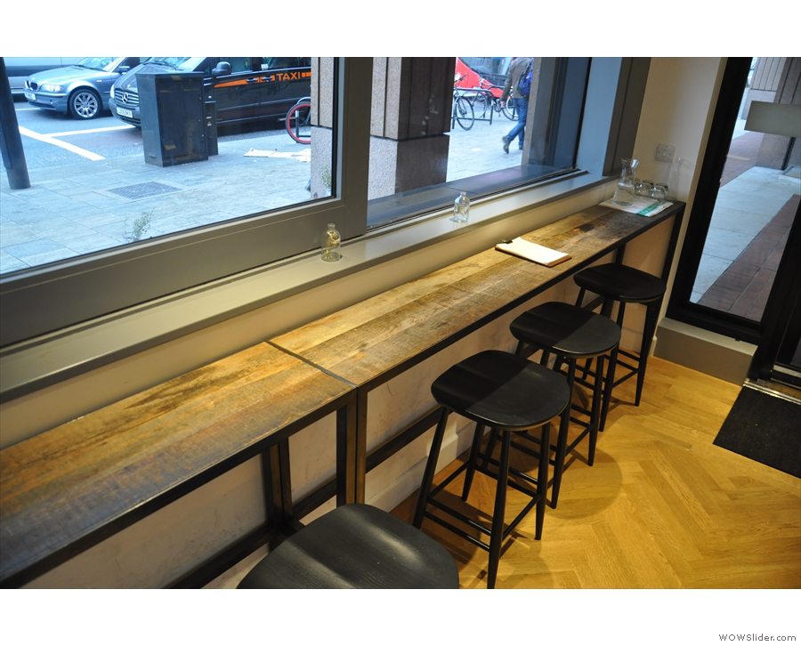 The entrance-end of the window-bar, which runs the full length of the coffee shop...