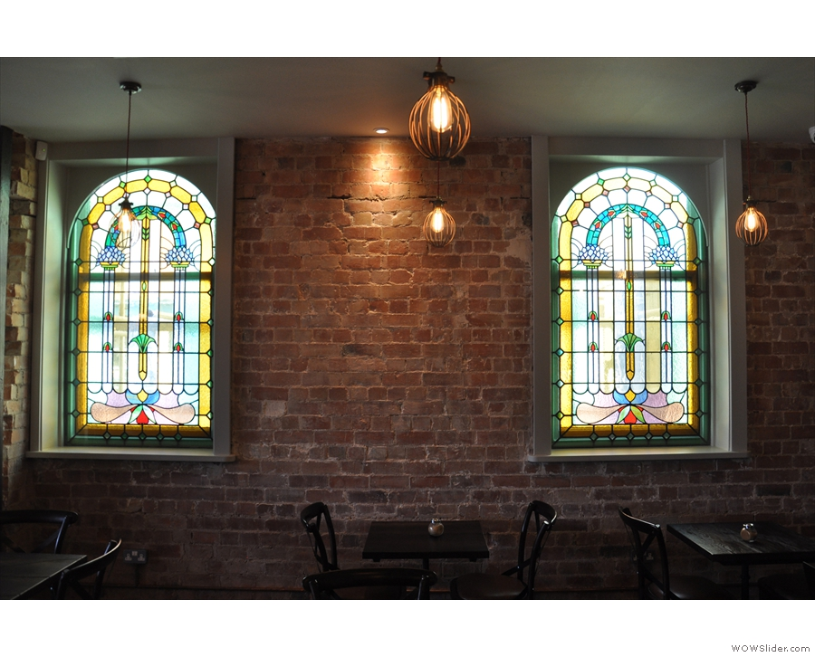 There are a couple of lovely stained-glass windows in the left-hand wall.