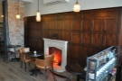 ... while on the other side are the equally familiar wooden clad-walls and fireplace.