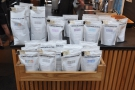 ... next to various bags of coffee for sale.