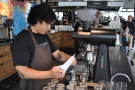 One of the baristas, weighing out some beans before grinding them in the EK-43.