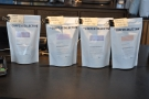 Bags of filter coffee by the till: a clever way of showing what's on bulk brew and pour-over.