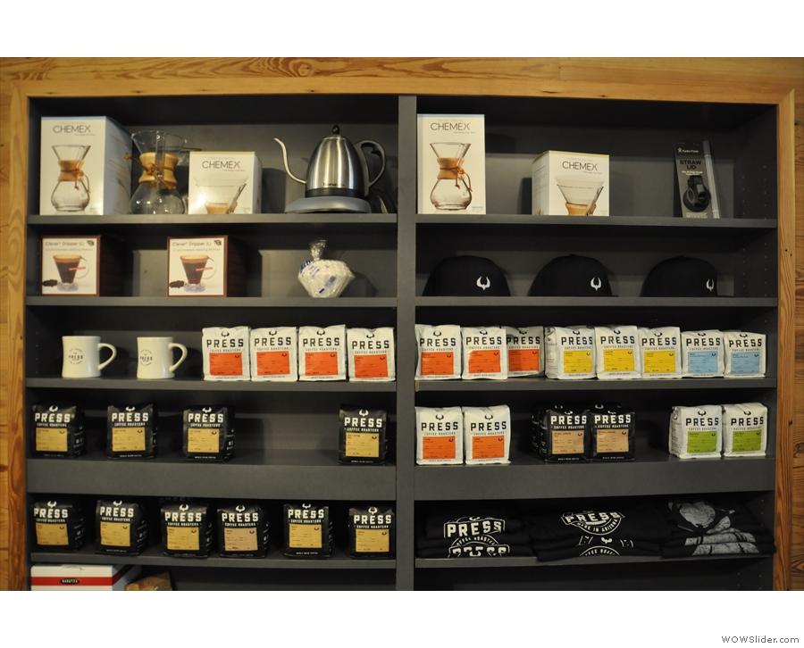 The merchandising shelves are opposite the espresso machine.