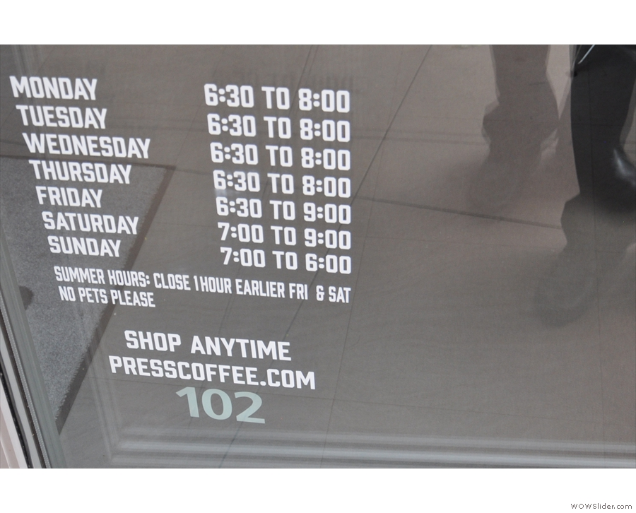 ... and handy opening times on the window to the right of the door.