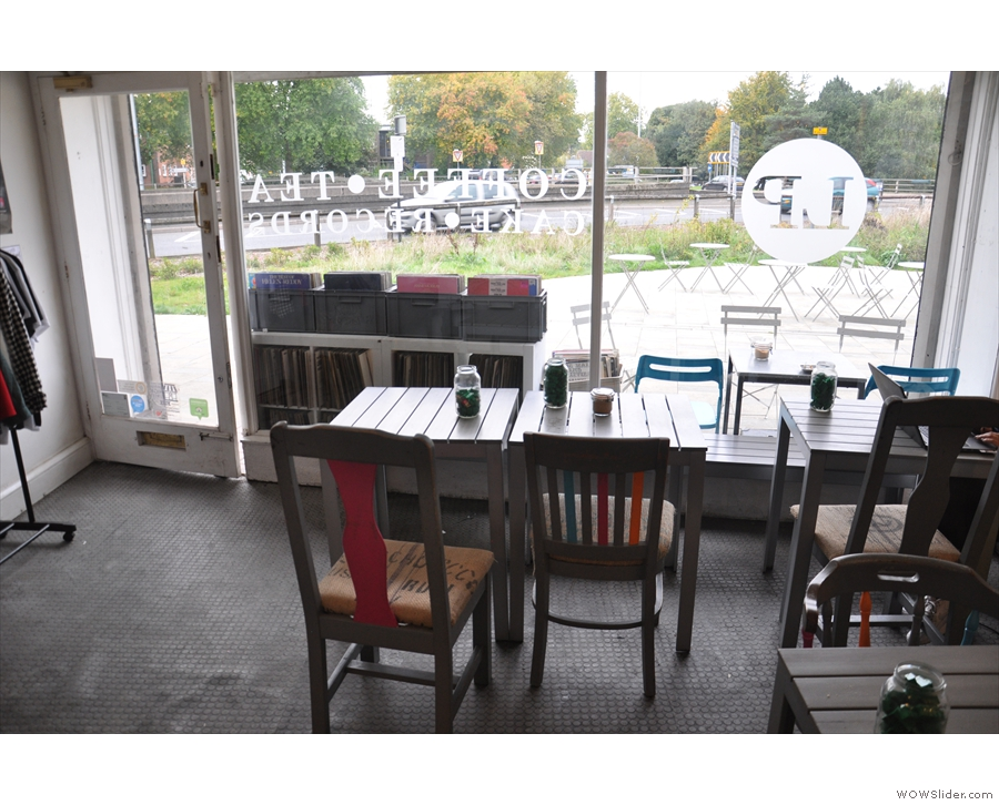 The seating's in the front/on the left-hand side. These two tables are in the window...