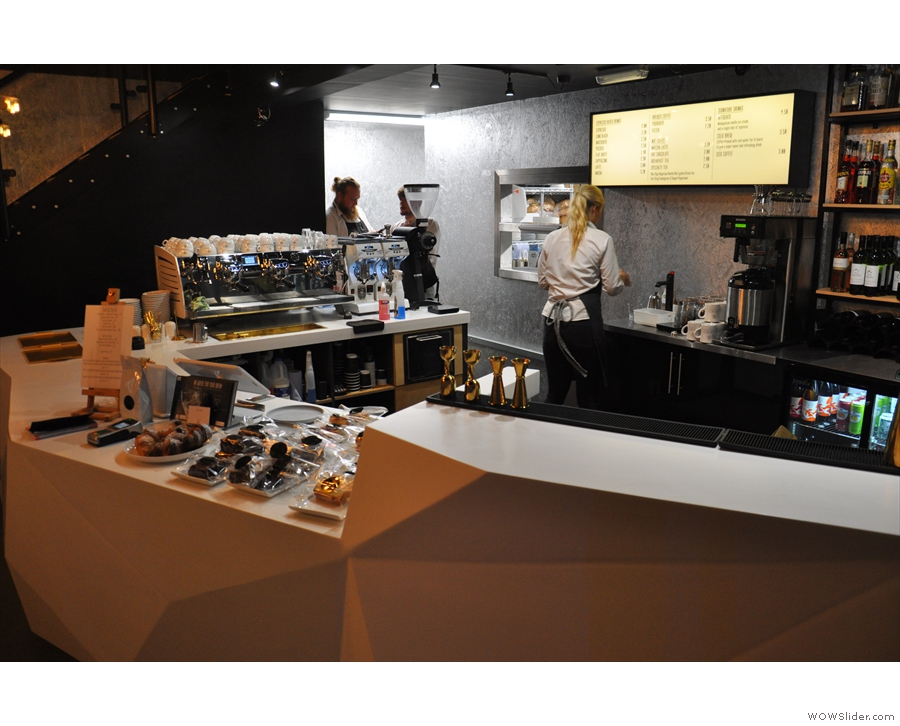 The view across the counter towards the espresso machine (left) and filter station (back).