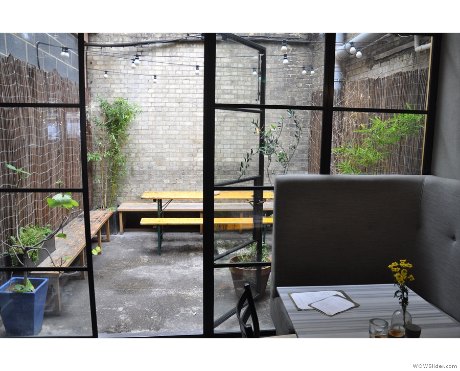 Even better, beyond a floor-to-ceiling glass partition, there's an outside seating area.