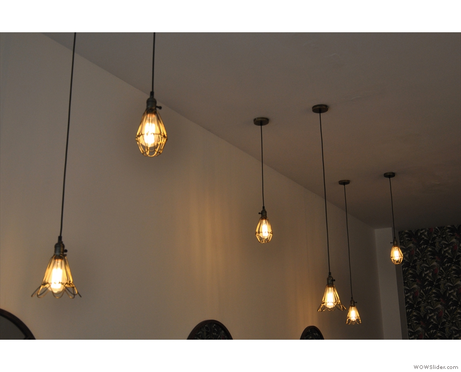 ... while these bulbs hang over the tables on the left.