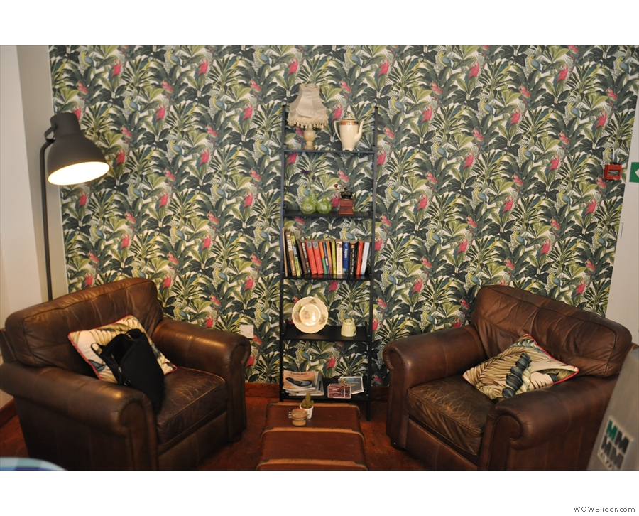 Finally, there are two armchairs right at the back with their own coffee table.