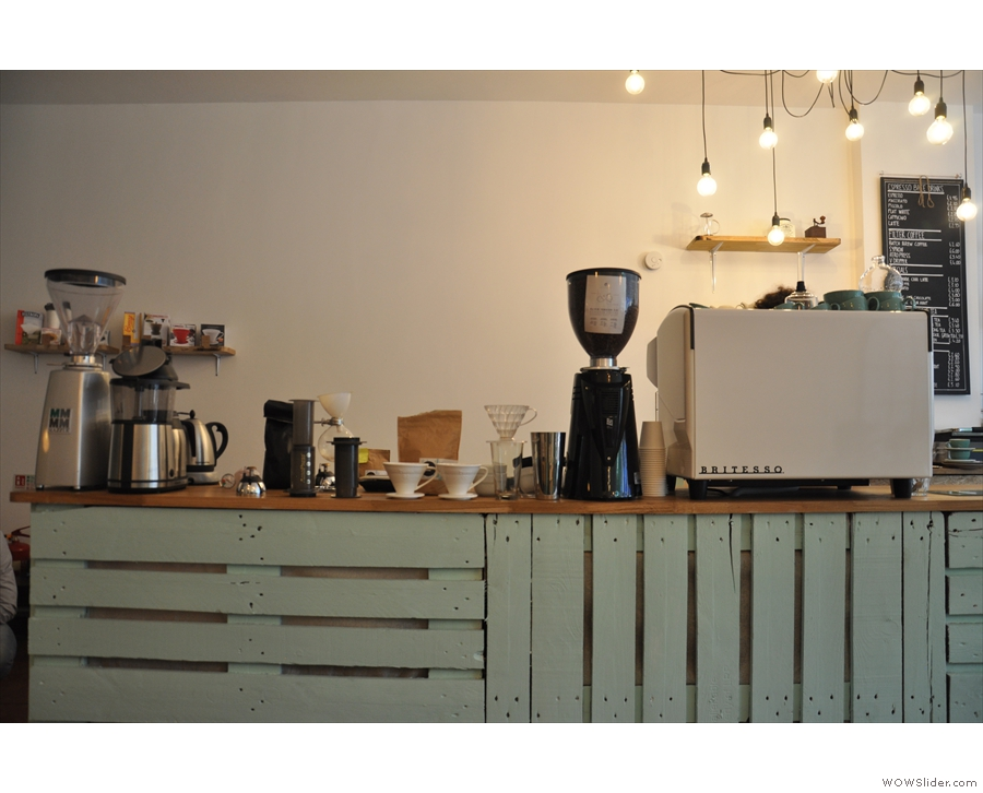 The coffee operation is at the far end of the counter...