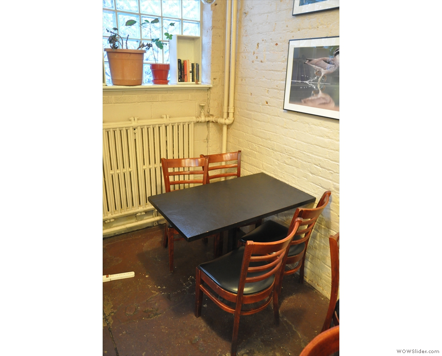 This is one of two four-person tables against the left-hand wall...