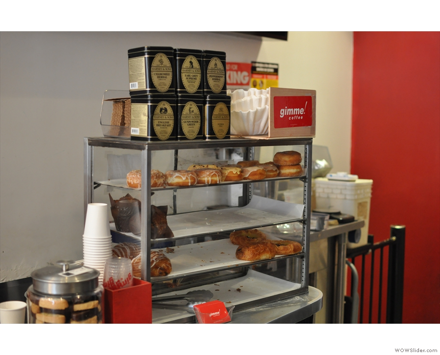 Every available space is made use of. Here's the cake counter with some awesome-looking doughnuts.I'll forgive them for putting the tea on the top...