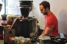 Barista at work. I liked the colour-scheme of white and red.