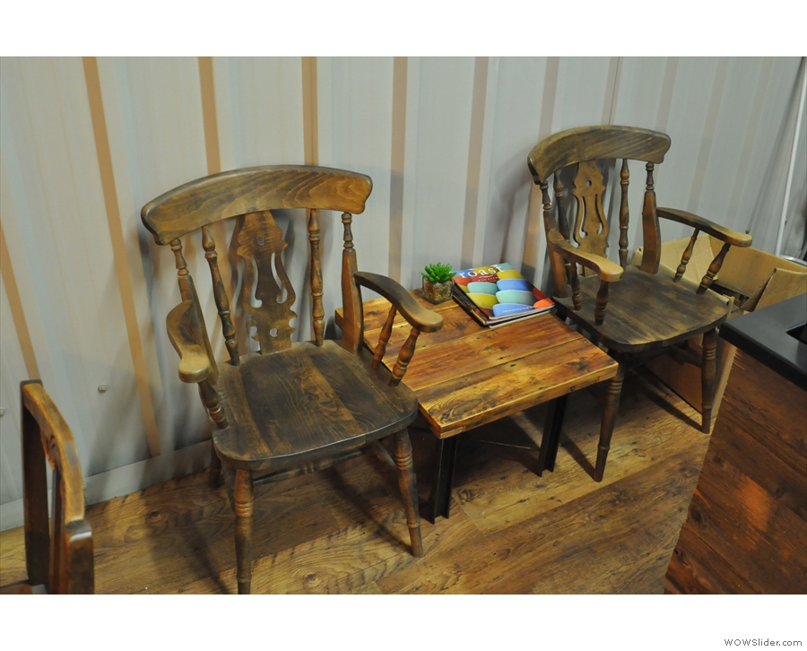 Right at the back, against the far wall, is this pair of chairs flanking a coffee table.