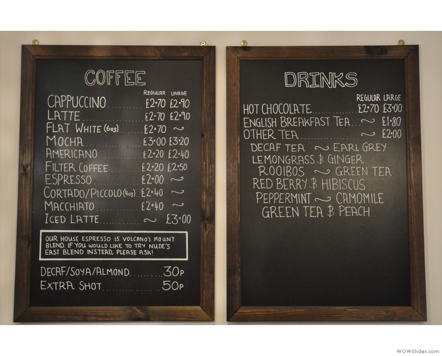 The menus are on the wall behind the counter, coffee on the left, other drinks on the right.