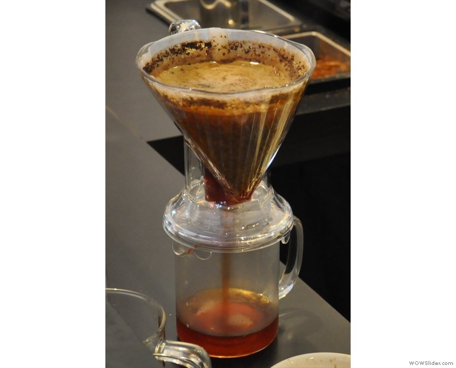 ... and when it's done, place it on the carafe and out comes the coffee...