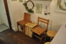 ... and at the back, on the right, beyond a narrow table, these chairs flank a coffee table.