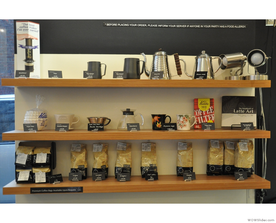 There's a retail shelf to the left of the door where you can buy lots of coffee-making kit...